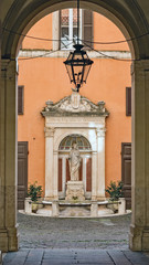 Fountain framed in archway, Rome, Italy