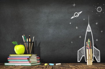 Back to School Concept with Hand Drawn Rocket on Blackboard