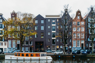 Architecture Of Dutch Houses Facade and Houseboats On Amsterdam Canal