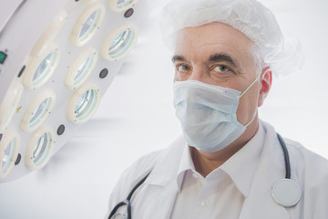 doctor in medical mask close-up, male