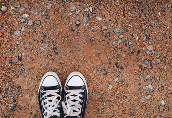Sneakers on the sravel background. Concept of walking and sport.