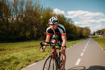 Cyclist in helmet and sportswear, bicycle training