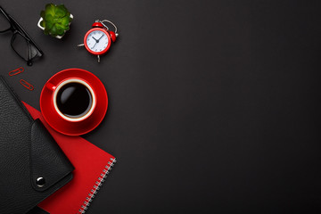 black background red coffee cup note pad alarm clock flower diary glasses empty place desktop