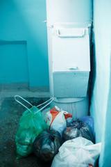 Garbage in bags on the floor