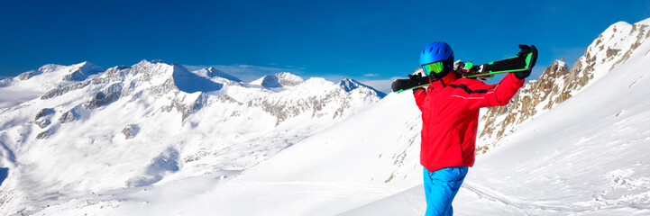 Fototapete - Man enjoying the stunning view before skiing in famous ski resort in Alps.