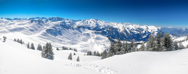 Fototapete - Swiss Alps covered by fresh new snow seen from Hoch-Ybrig ski resort, Central Switzerland