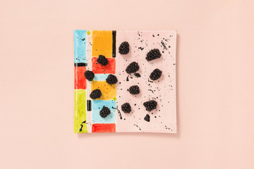Blackberries on a colorful ceramic plate