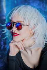 blonde in stylish sunglasses