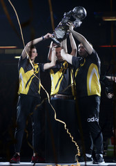 Dignitas' Turbopolsa, Kaydop and ViolentPanda celebrate with the trophy after winning the final match against NRG Esports in the Rocket League Championship Series Finals in London