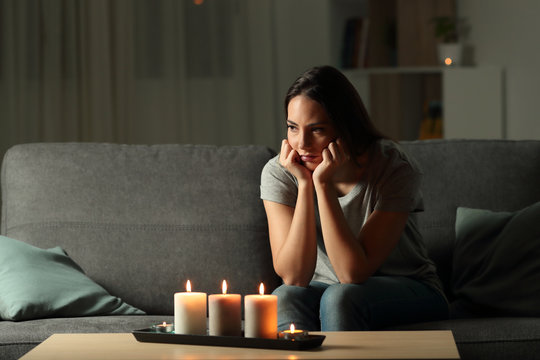Angry woman boring during a blackout in the night