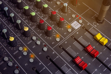 Audio mixing console knobs. Slide Red Control System audio mixer.