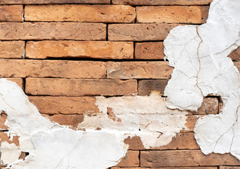 Grunge orange brick wall with crack white cement plaster texture background,outdoor wall.