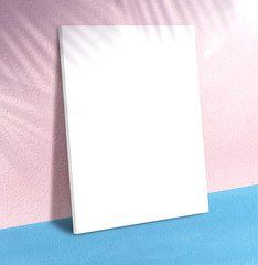 Blank poster at pastel pink wall and blue floor with palm leaf shadow with sunbeam background,Mock up studio room for display of product for advertising on media,Summer holiday vacation presentation.
