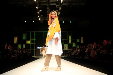 A model presents creations by student designer Runny Soemadipradja on the first day of the Indonesia Muslim Fashion Festival in Jakarta