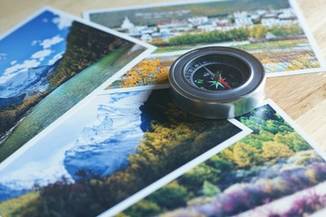 Compass on blur nature photograph of popular tourist destination in autumn background, China traveling concept