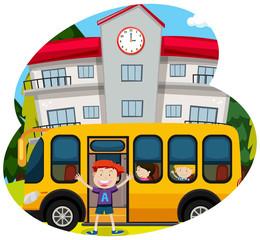 Happy boy infornt of a school bus