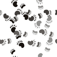 Trail the bear paw. Seamless pattern background. Wildlife design vector illustration.