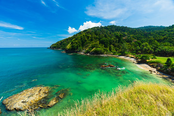 Summer seascape view with clear sea, green forest and blue sky on koh Lanta island in Thailand.