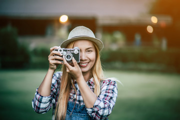Young woman model with retro film camera