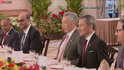 Singapore's Prime Minister Lee Hsien Loong  speaks with U.S. President Donald Trump ahead of a summit with North Korean leader Kim Jong Un, at the Istana