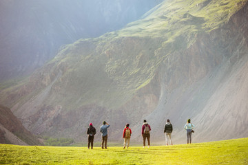 Group of people against mountains valley