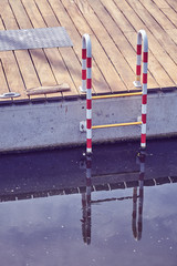 Vintage toned picture of a marina ladder.