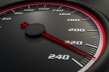 Red speedometer in car on dashboard