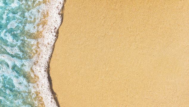 Soft wave lapped on empty sandy beach, Summer Background. copy space.