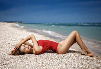 Beautiful girl in a sexy swimsuit in a beach