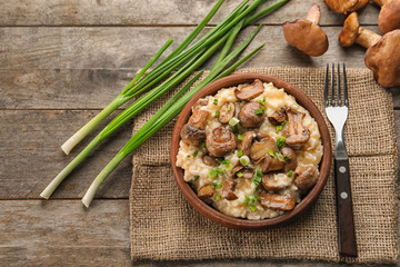 Composition with delicious risotto on wooden background, top view