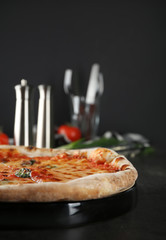 Tasty pizza on table. Fresh from oven