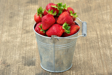 Small metal bucket with strawberries