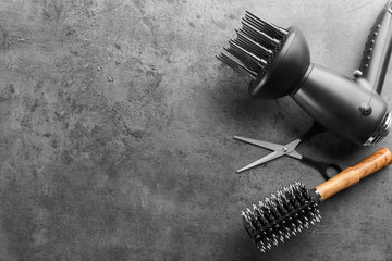 Flat lay composition with set of hairdresser's tools on grey background Wall mural