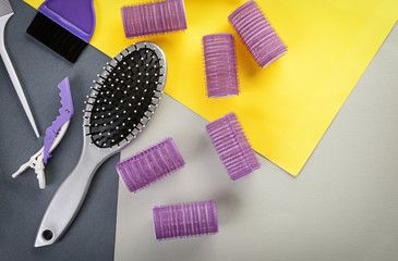 Flat lay composition with set of hairdresser's tools on color background