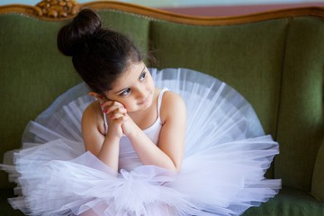 Little girl ballerina in white tutu