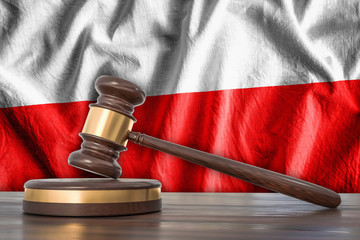Wooden gavel and flag of Poland on background - law concept