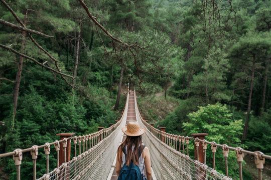 Woman on rope bridge