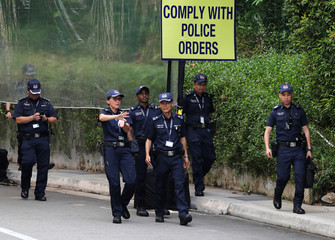 Police officers walk at the Capella Hotel, the venue for the June 12 summit between U.S. President Donald Trump and North Korean leader Kim Jong Un, on Singapore's resort island of Sentosa