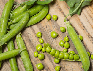 fresh green pea legumes on a wooden table