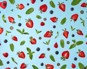 pattern of fresh berries isolated on blue background