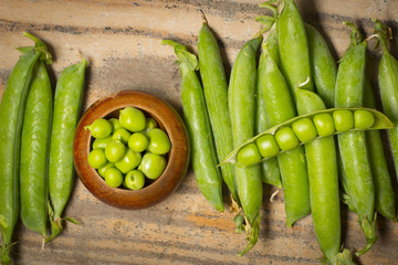 fresh pea on am old wooden kitchen table