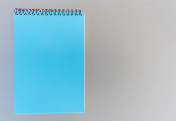 Blank notepad on brown background.