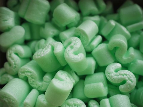 Box of green packing peanuts