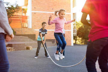Children playing with skipping rope