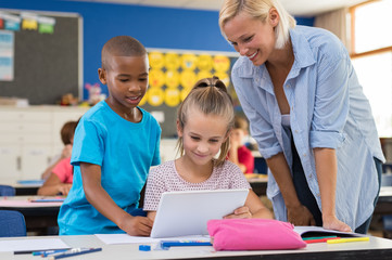 Kids using digital tablet in classroom
