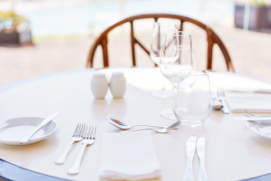 Classic Dinnerware in the restaurant. Table appointments for dinner on terrace