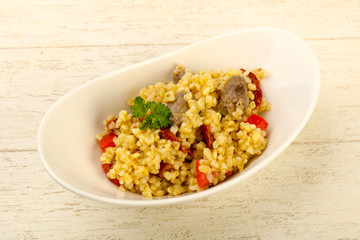 Bulgur with chicken hearts