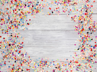 confetti on a wooden background with copy space