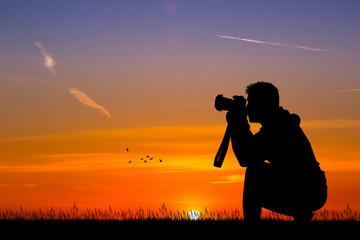 man photographer at sunset