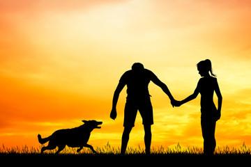 man and girl with dog